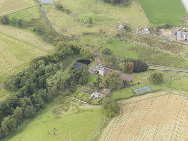 Oblique aerial view of Cakemuir Castle, looking to the W.