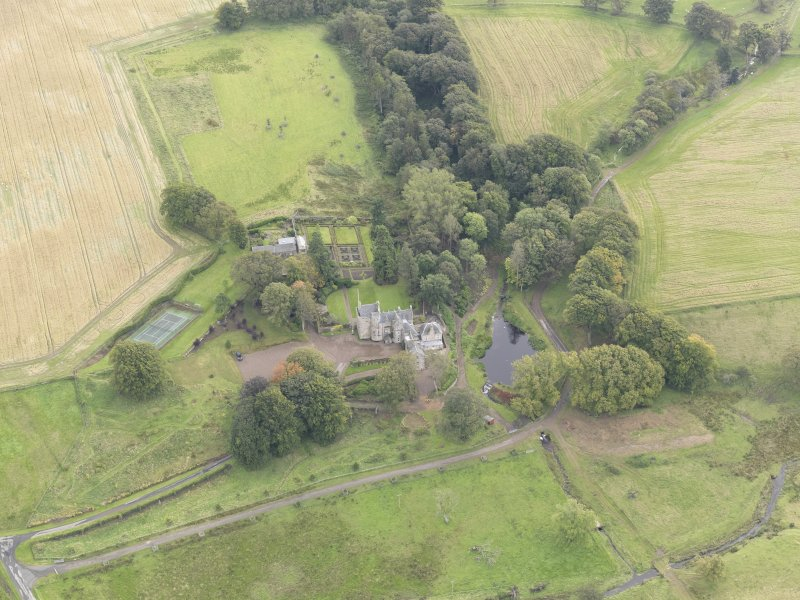 Oblique aerial view of Cakemuir Castle, looking to the SSE.