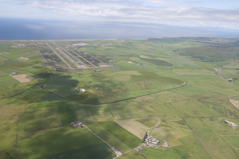 General oblique aerial view of Campbeltown Airport and Tangy Wind Farm, looking NW.