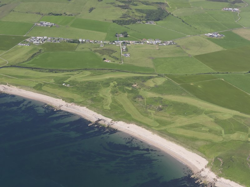Oblique aerial view of Dunaverty Golf Course, Southend and Brunerican Bay, looking NW.