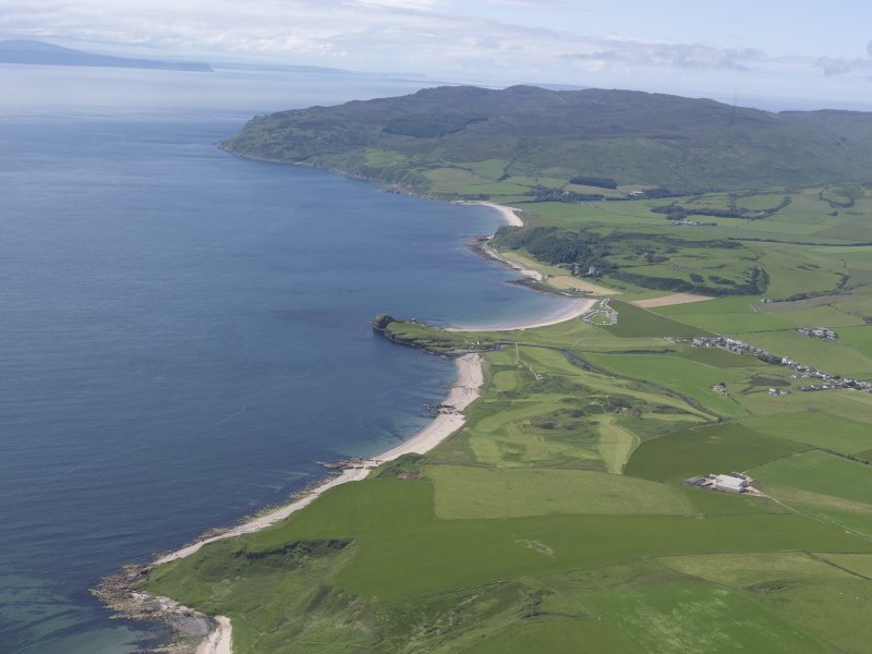 General oblique aerial view of Dunaverty Golf Course, Southend and Brunerican Bay with Ireland beyond, looking W.