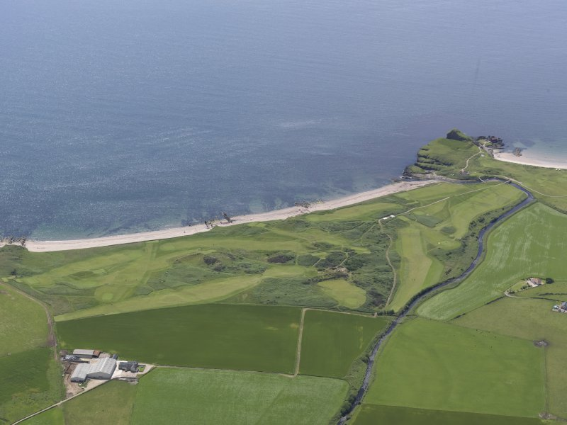 Oblique aerial view of Dunaverty Golf Course, Southend and Brunerican Bay, looking SW.