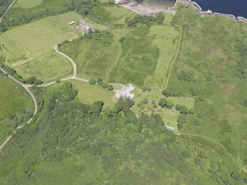 Oblique aerial view of Cour House, looking NE.