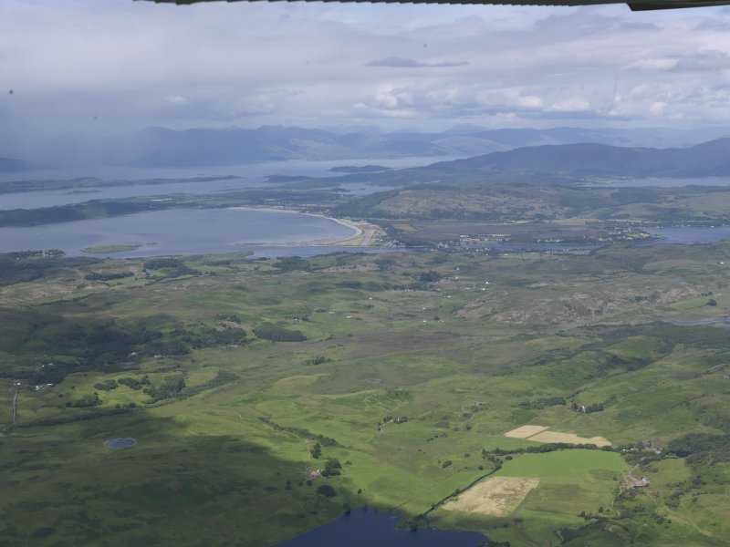 General oblique aerial view of Connel airfield with Loch Linnhe beyond, looking N.