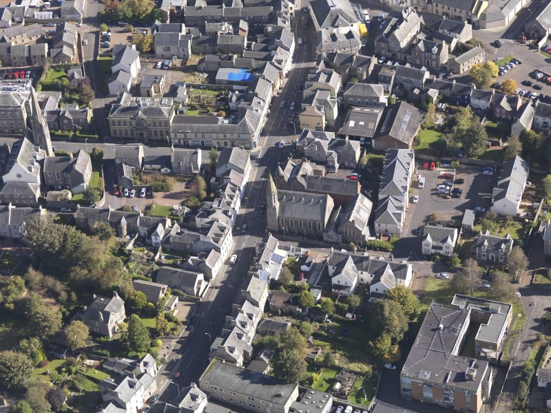 General oblique aerial view of Lanark High Street centred on St Nicholas Church, taken from the W.