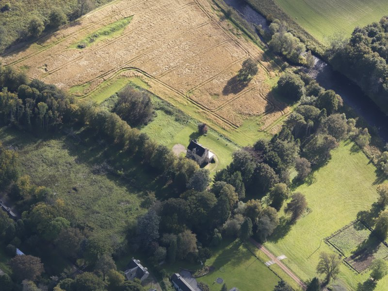 Oblique aerial view of Castle Newe, taken from the NW.