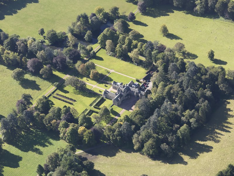 Oblique aerial view of Glenkindie House, taken from the NE.