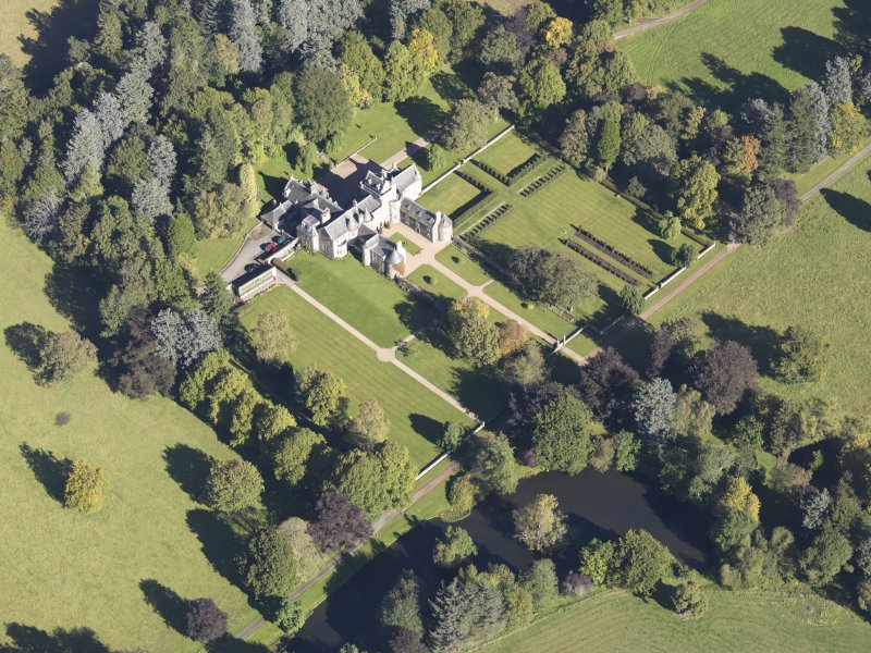 Oblique aerial view of Glenkindie House, taken from the SW.