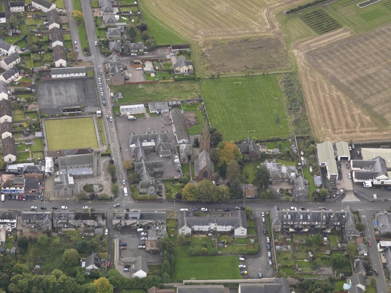 Oblique aerial view of St Columba's Church Invergowrie, taken from the NNE.