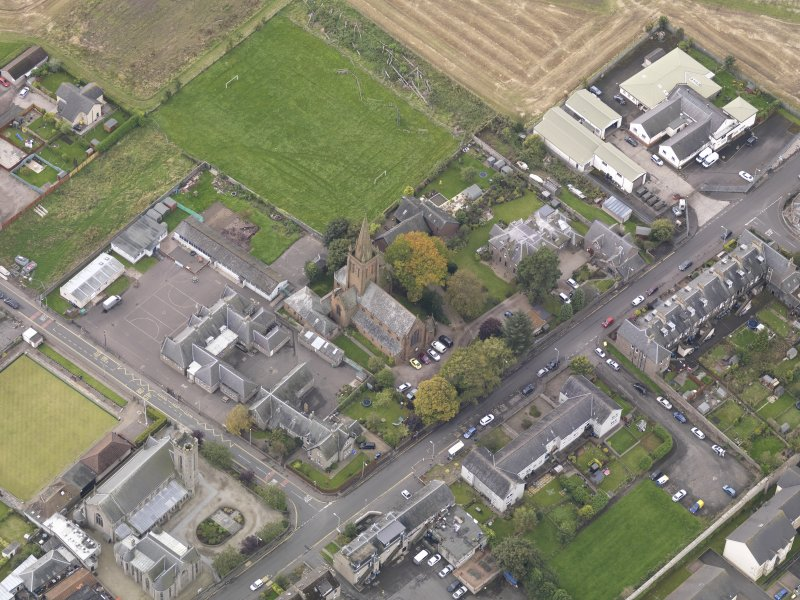 Oblique aerial view of St Columba's Church Invergowrie, taken from the NE.