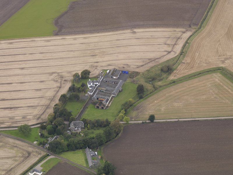 Oblique aerial view of Benvie Farm Buildings and Church, taken from the NE.