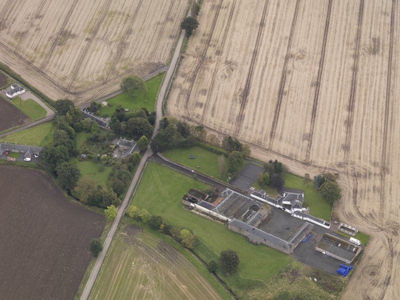 Oblique aerial view of Benvie Church and farm buildings, taken from the N.