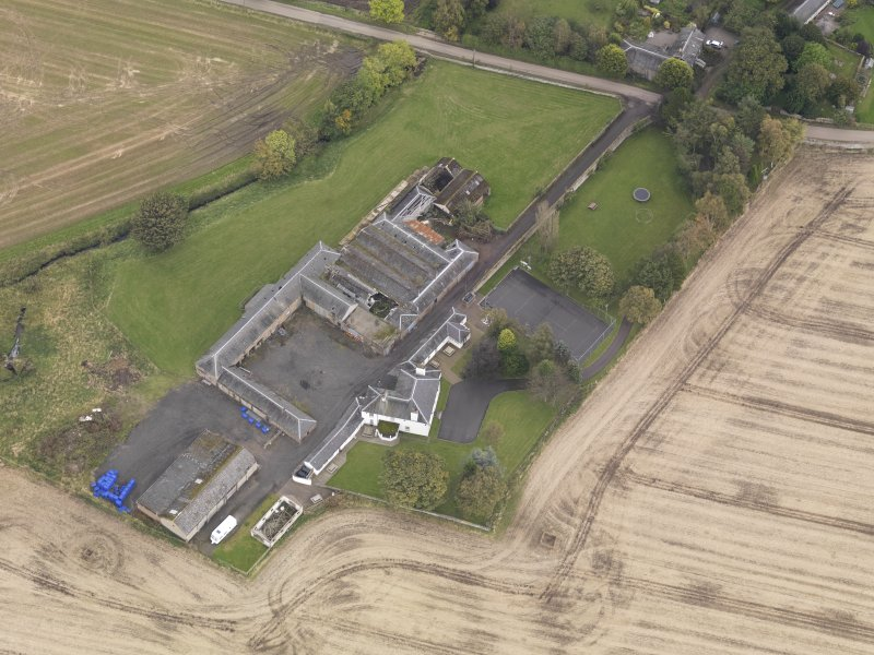 Oblique aerial view of Benvie Farm Buildings, taken from the W.
