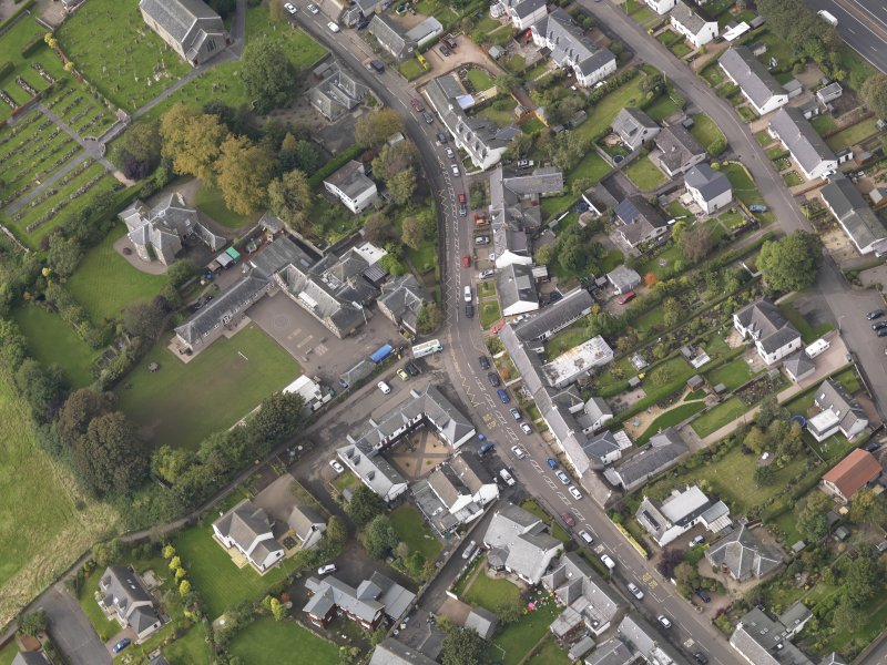 Oblique aerial view of Longforgan Main Street, taken from the SE.