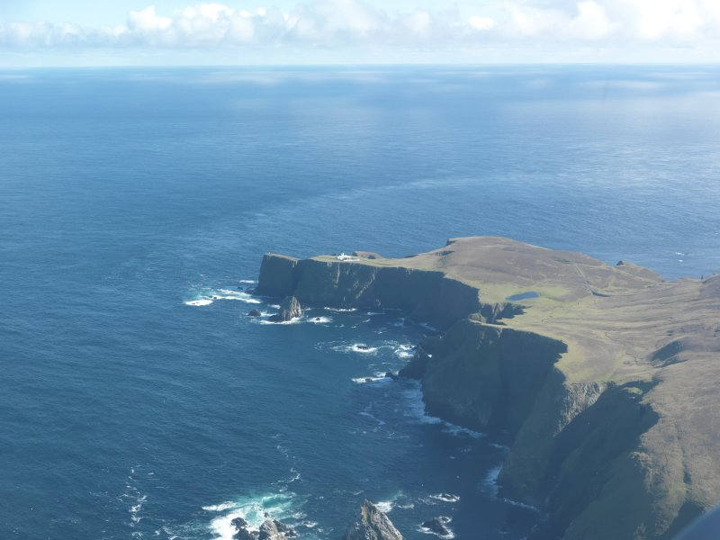 General oblique aerial view of Skroo Lighthouse, Fair Isle, looking SE.
