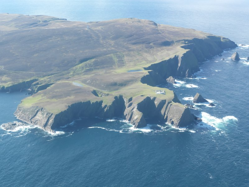 General oblique aerial view of Skroo Lighthouse, Fair Isle, looking SW.