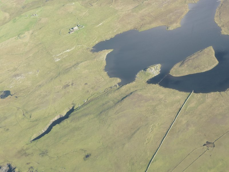 Oblique aerial view of Priesthoulland, Loch of Houlland, looking NE.