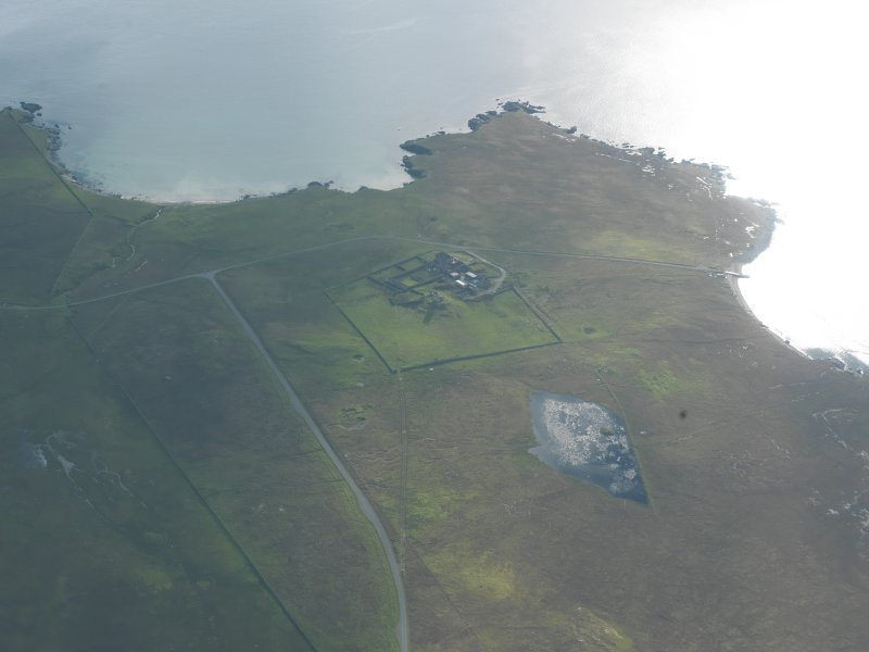 General oblique aerial view of Brough Lodge, Fetlar, looking SSW.