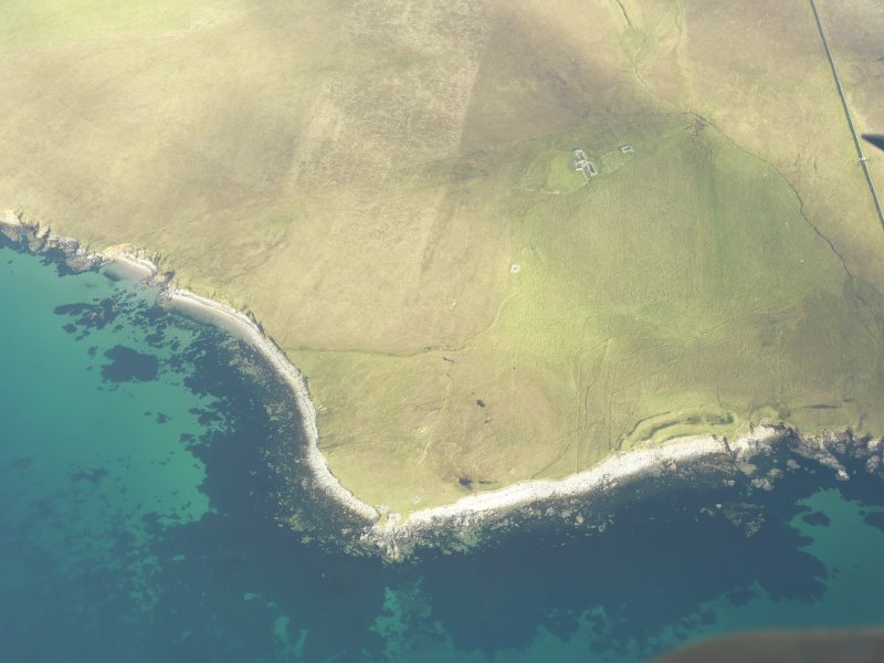 General oblique aerial view of Snabrough, Fetlar, looking SE.