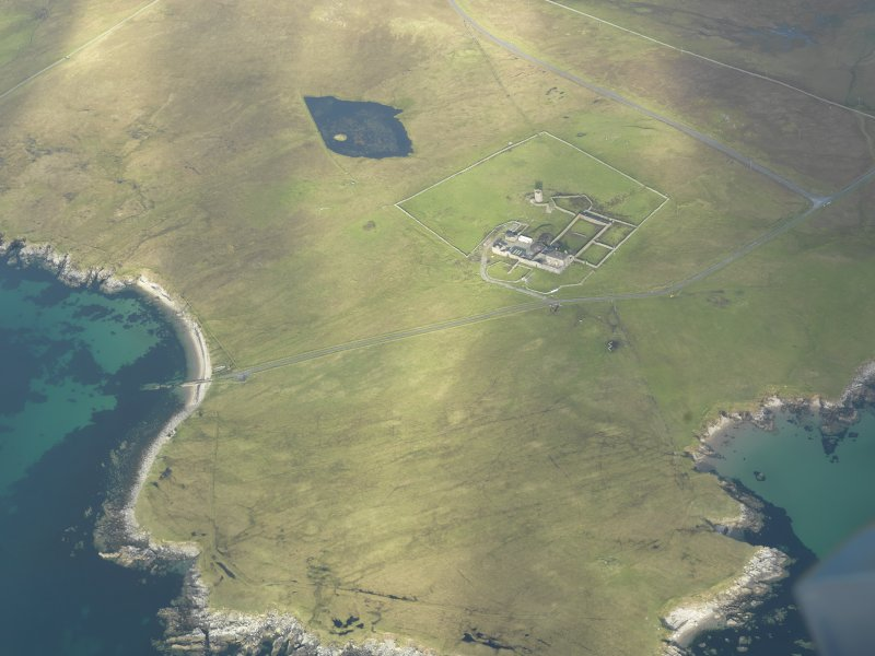 Oblique aerial view of Brough Lodge, Fetlar, looking NE.