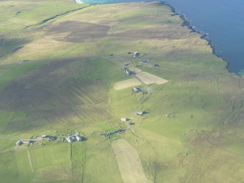 General oblique aerial view of Muness Castle, Unst, looking N.