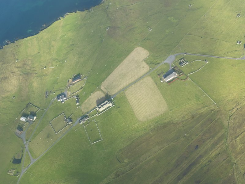 General oblique aerial view of Muness Castle, Unst, looking NE.