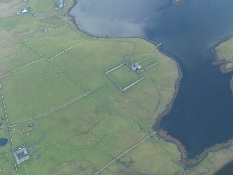 Oblique aerial view of West Sandwick House, North Haa, Unst, looking SSE.