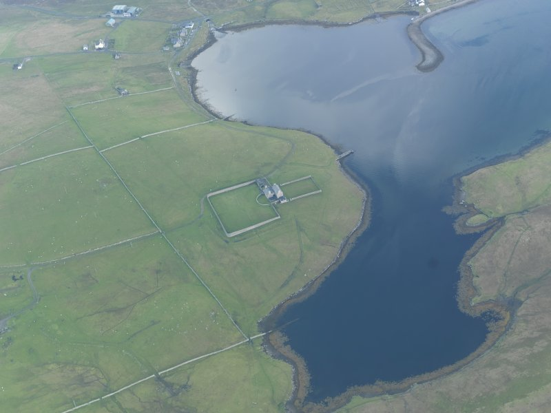 Oblique aerial view of West Sandwick House, North Haa, Unst, looking SE.