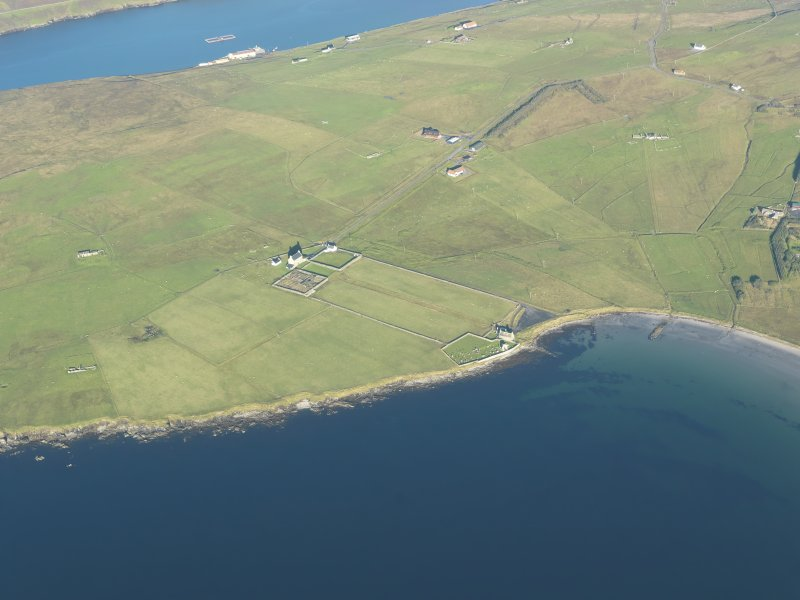 General oblique aerial view of St Marys Chapel and Haa of Sand, looking NW.