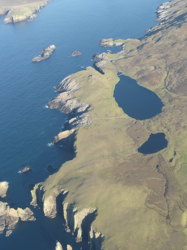 Oblique aerial view of Broch of Culswick, looking N.