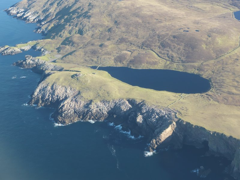 Oblique aerial view of Broch of Culswick, looking NE.