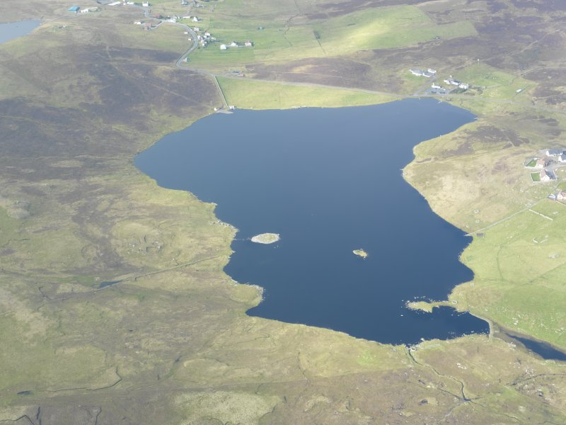 General oblique aerial view of Symbister and Loch of Huxter, looking NW.
