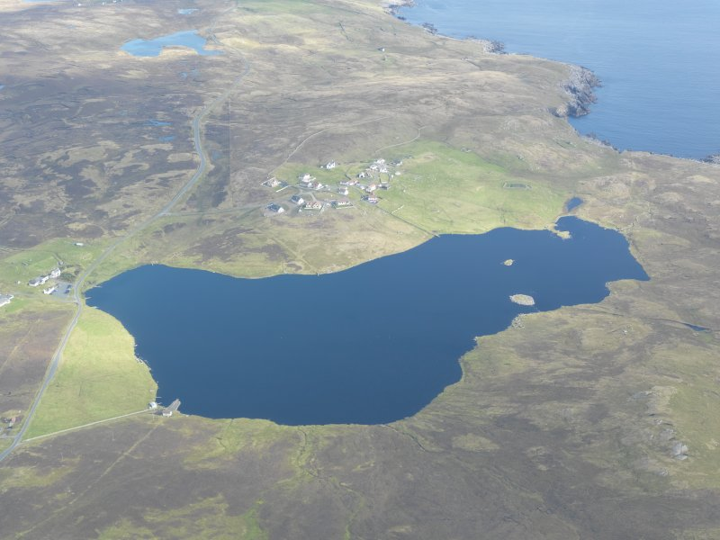 General oblique aerial view of Huxter and Loch of Huxter, looking NE.