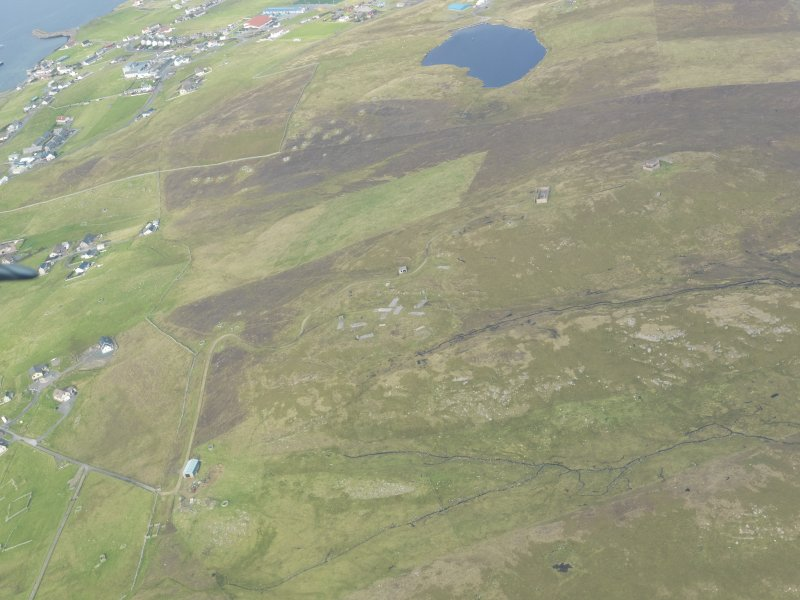 General oblique aerial view of Symbister and Clett radar station, looking NW.
