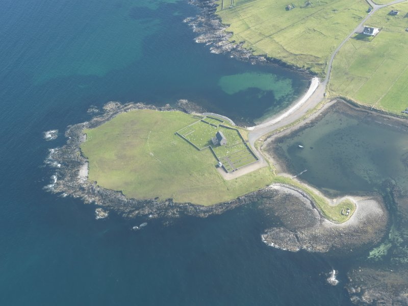 Oblique aerial view of Whalsay Kirk, Kirk Ness, looking SE.