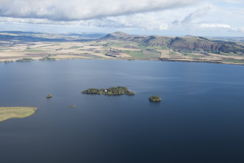 General oblique aerial view of Loch Leven centred on Loch Leven Castle with the Lomond Hills beyond, taken from the SW.