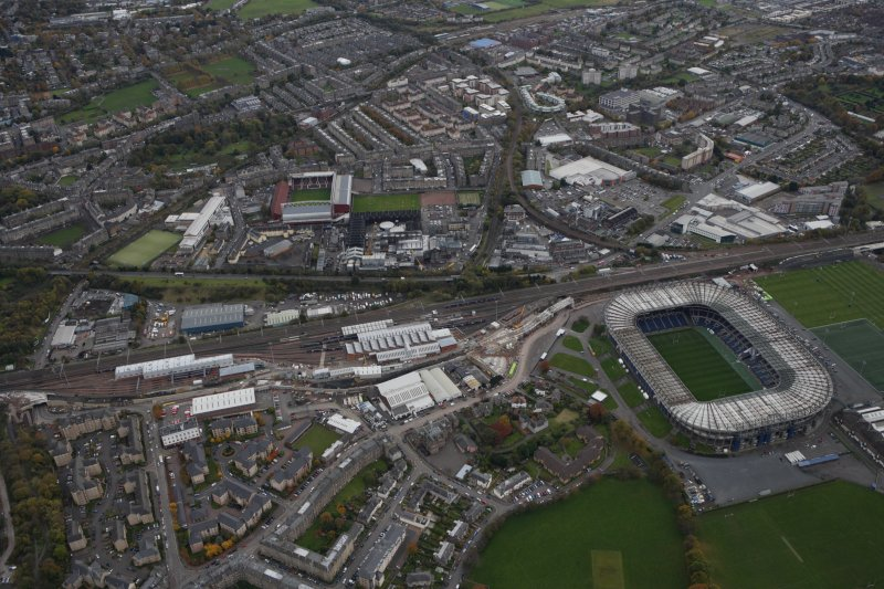 General oblique aerial view of the Murrayfield Stadium with Tynecastle Park Stadium beyond, looking S.