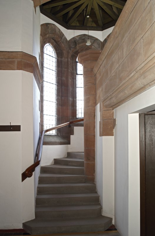 Interior. Entrance hall, stair to balcony, view from west