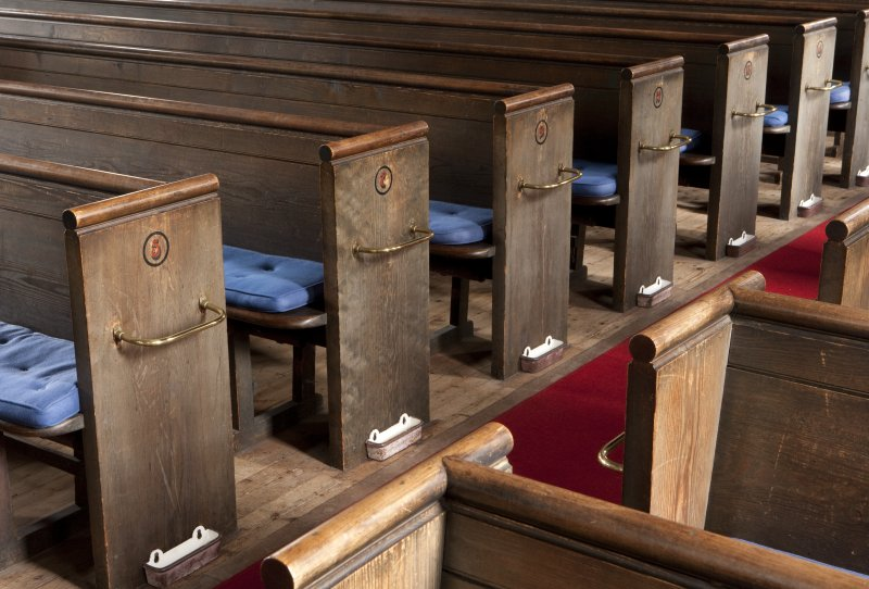 Interior. Detail of pew ends in nave
