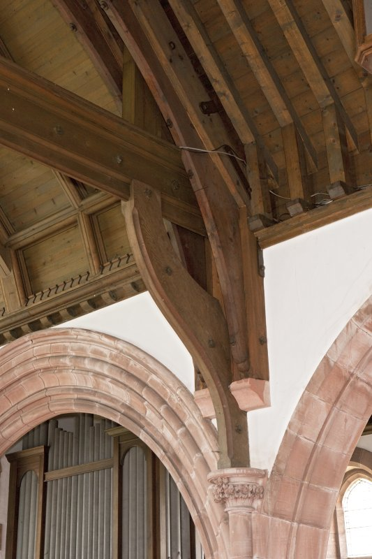 Interior. Detail of roof truss and corbels
