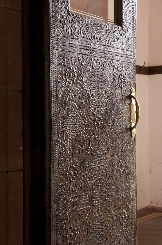 Interior. Detail of internal door with textured fabric