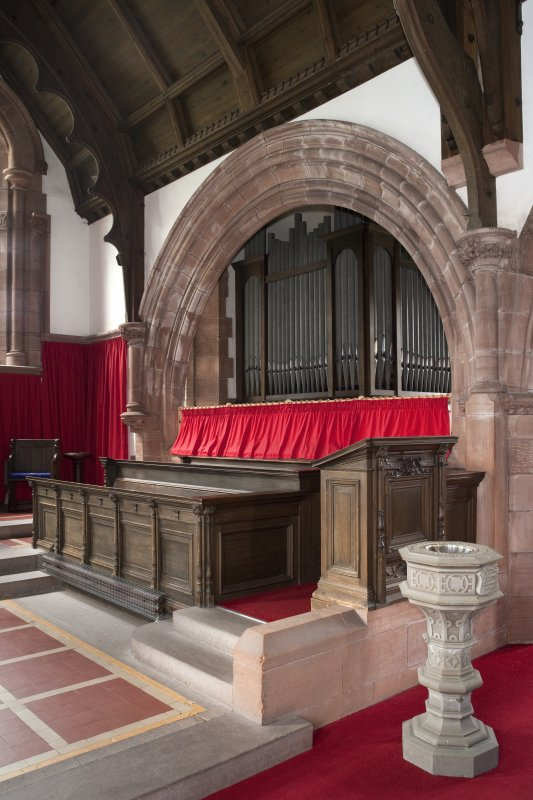 Interior. Choir stalls and font, view from south east
