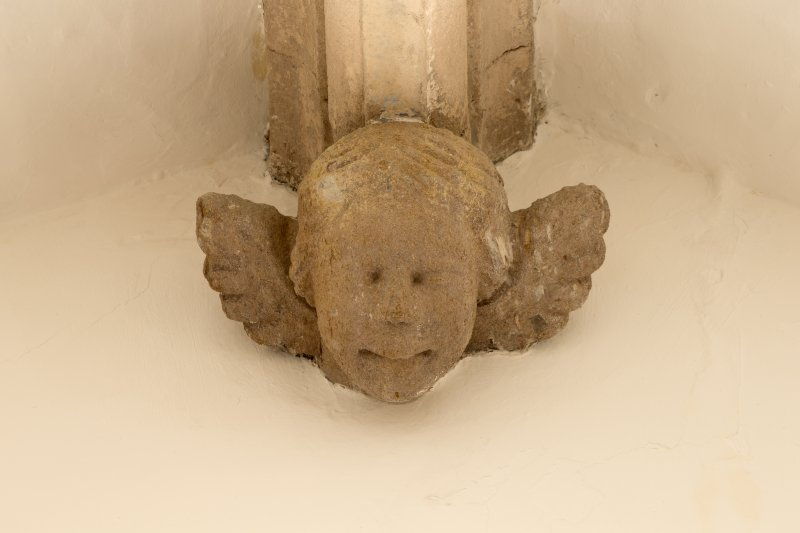 1st floor mezzanine. 'Solar'/ library. Detail of carved stone head corbel.