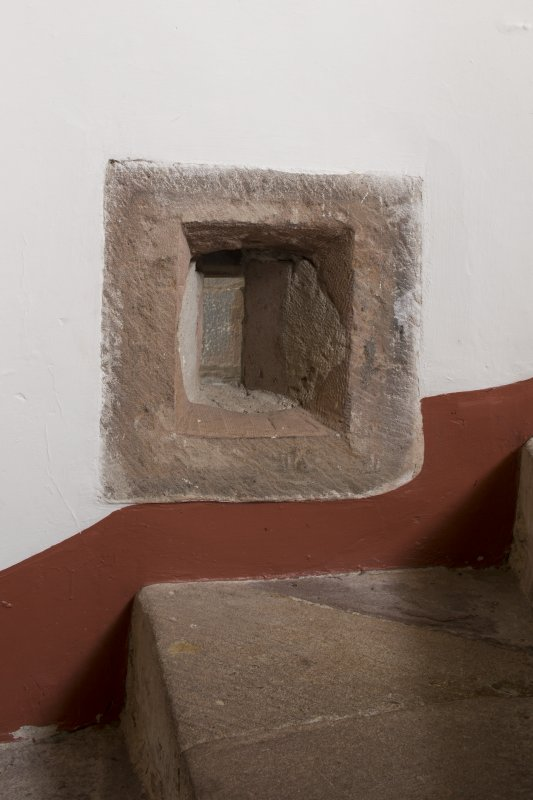 Ground floor. Staircase. Detail of gunloop window on internal wall.