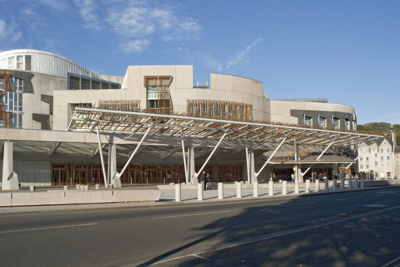 View looking west across Queen's Drive towards the main entrance, glazed walkway and pergola of the Scottish Parliament's east elevation