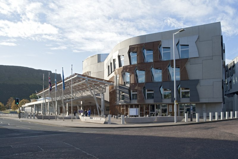View looking south west across the corner of Queen's Drive and Canongate to the Media Tower, main entrance and canopies of the Scottish Parliament
