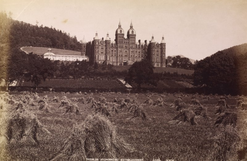 General view of Peebles Hydropathic Establishment showing gardens and cornfield below. Titled: 'Peebles Hydropathic Establishment. 6996. G.W.W.'
