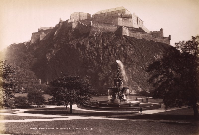 Edinburgh, Princes Street Gardens. View taken of the castle from the Gardens. Titled: 'ROSS FOUNTAIN & CASTLE ROCK J.P.13.' PHOTOGRAPH ALBUM No.195:  Photographs by G W Wilson & Co. Blue leatherbound album