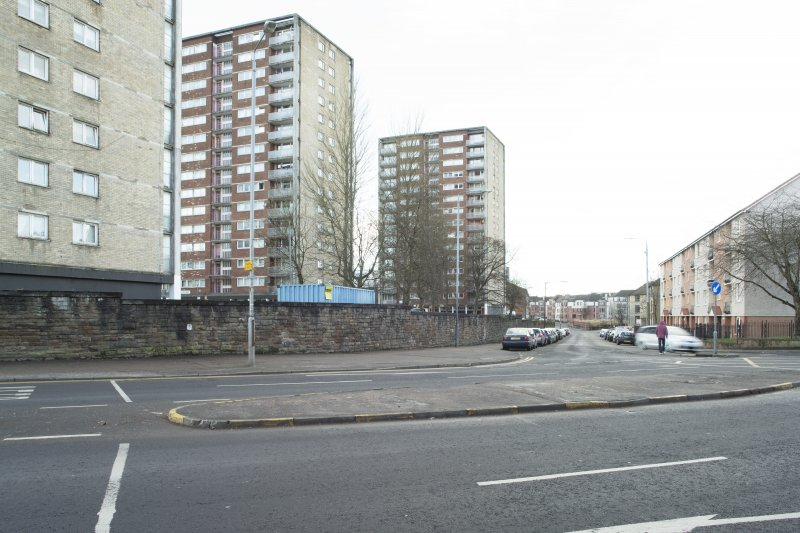 General view of the perimeter walls of the former Maryhill Barracks site, taken from the north east, at the junction of Maryhill Road and Kelvindale Road.