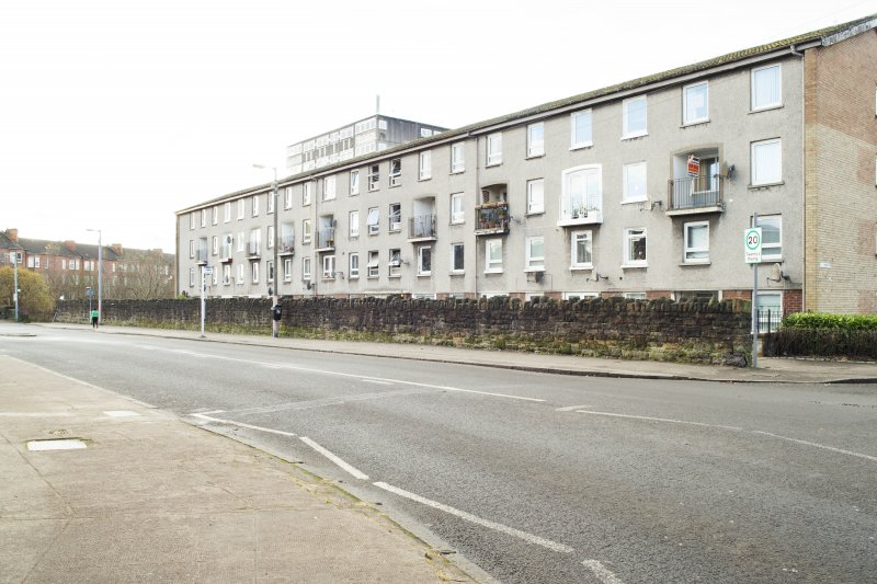 General view of the perimeter walls of the former Maryhill Barracks site, taken on Garioch Road from the north.